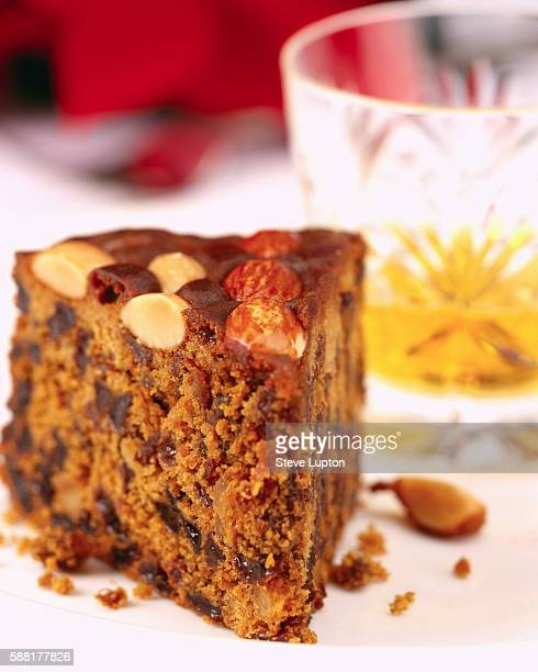 slice of dundee cake - fruit cake stock pictures, royalty-free photos & images
