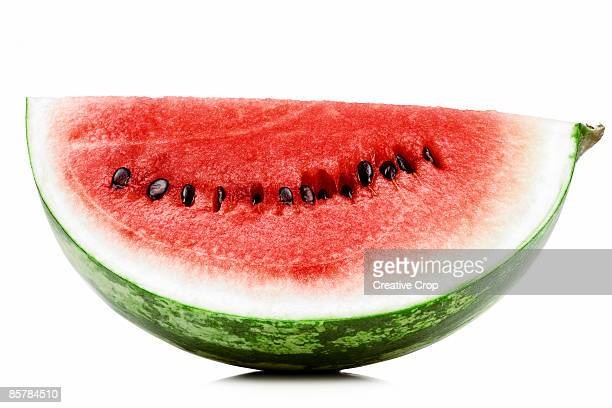 a slice of fresh red watermelon - watermelon stock pictures, royalty-free photos & images