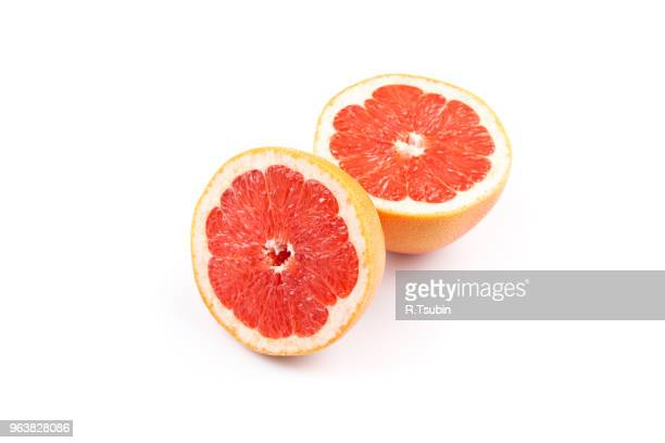 slice of grapefruit isolated on white background - grapefruit red stock pictures, royalty-free photos & images