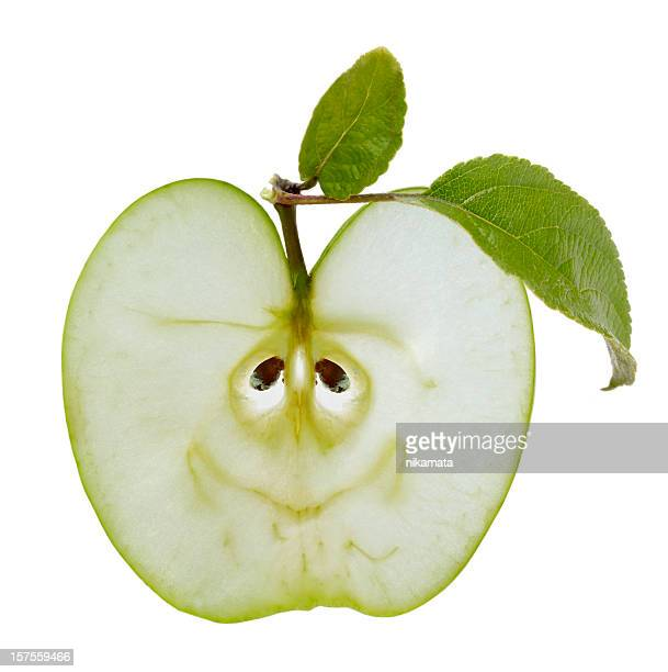slice of green apple as a smiley - core stock pictures, royalty-free photos & images