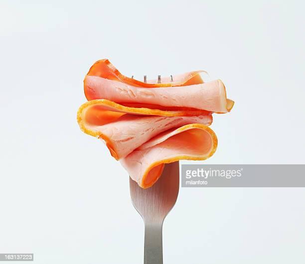 Slice of ham on a fork