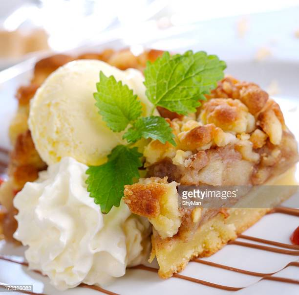 A slice of home made apple pie topped with ice cream