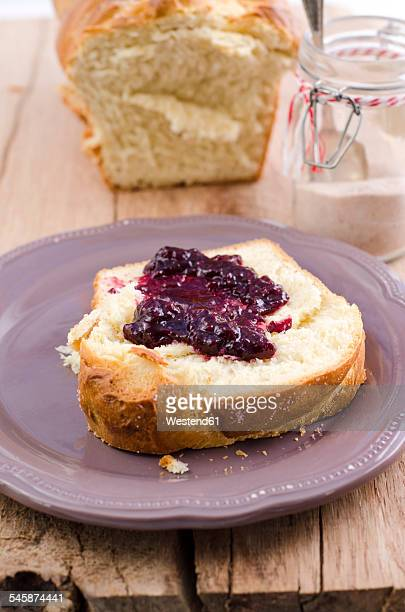 Slice of home-baked brioche with wild berry jam