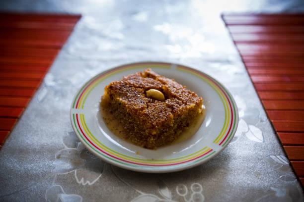 Slice of kalb el louze pastry on plate