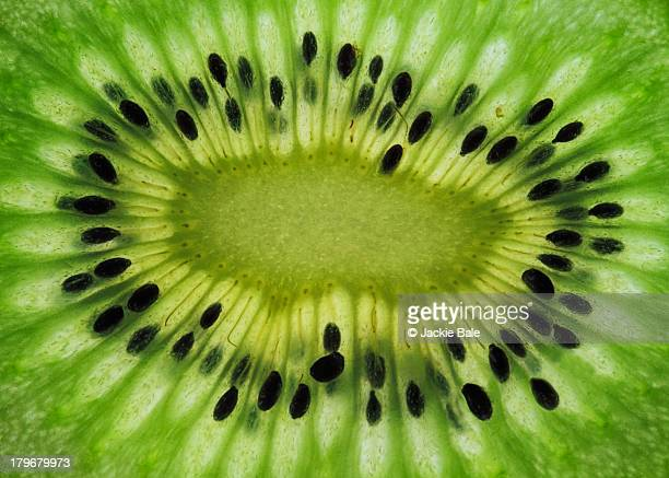 a slice of kiwi fruit - extreme close up stock pictures, royalty-free photos & images