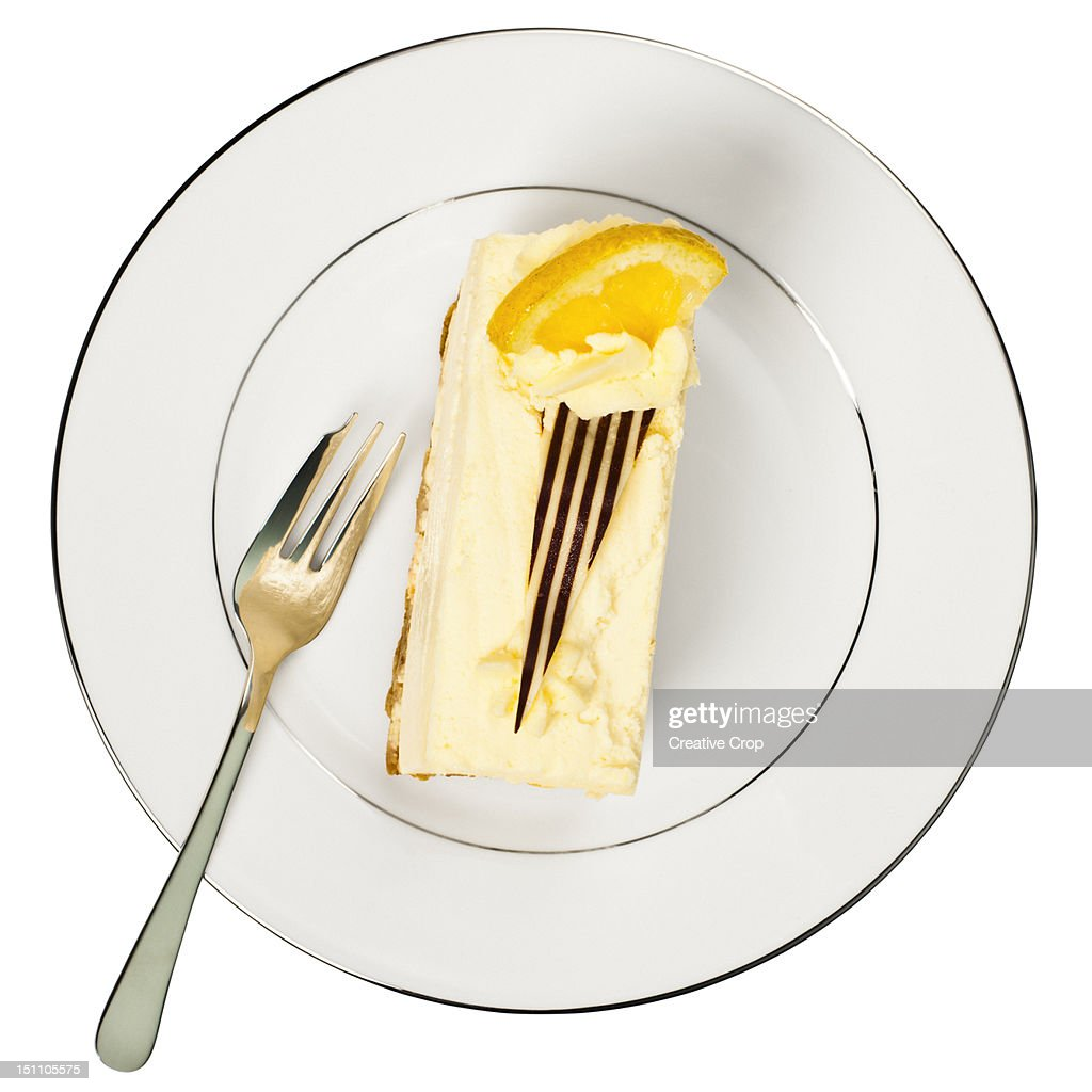 Slice of lemon cheese cake on a white plate : Stock Photo
