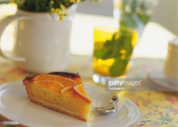 A slice of orange tart on plate