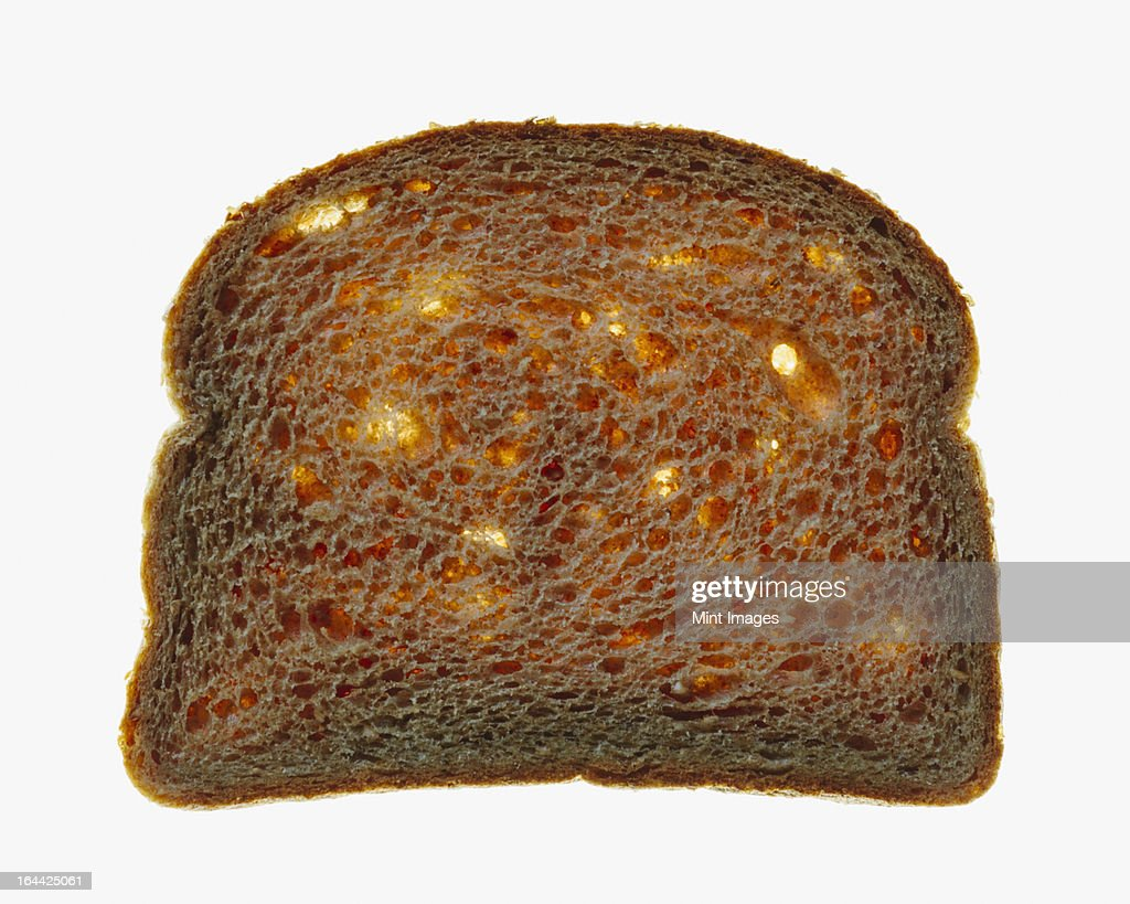 Slice Of Organic Whole Wheat Bread On A White Background Stock Photo