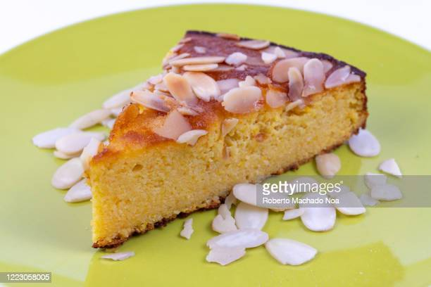 Slice of pastry made using a ketogenic diet recipe. The sweet food is made with coconut flour and coconut oil.
