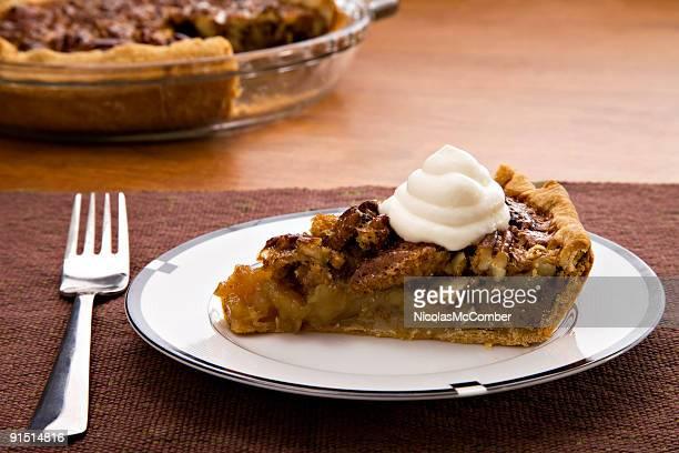 slice of pecan pie with cream - pecan pie stock photos and pictures