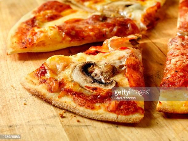 Slice of Pepperoni and Mushroom Pizza