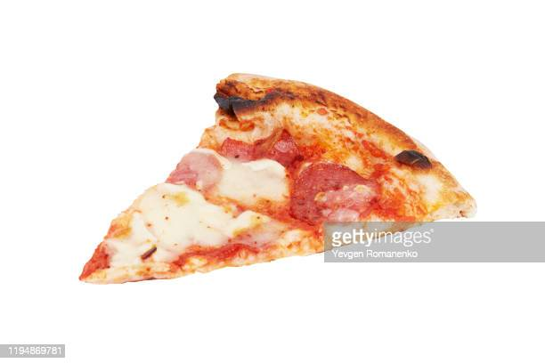 slice of pepperoni pizza isolated on a white background - halved stock pictures, royalty-free photos & images