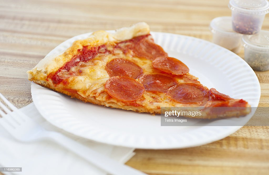 Slice of pepperoni pizza on plate : Stock Photo