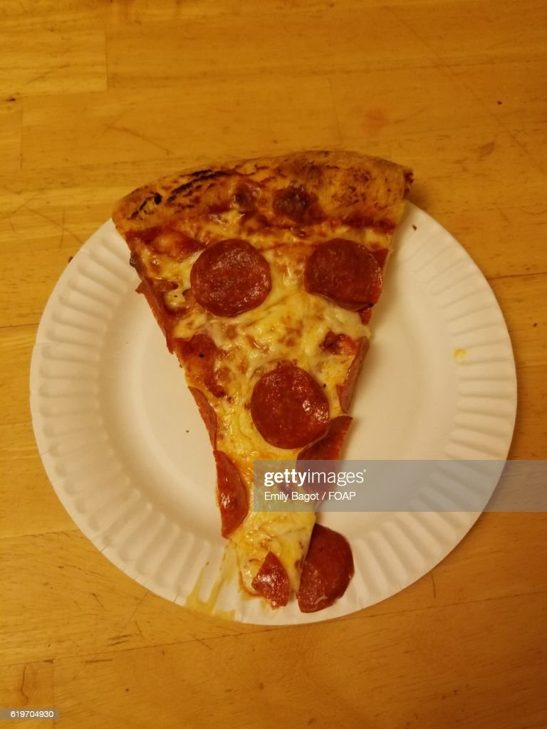 Keywords & Greasy Stain From Pizza Slice On Paper Plate Stock Photo | Getty ...