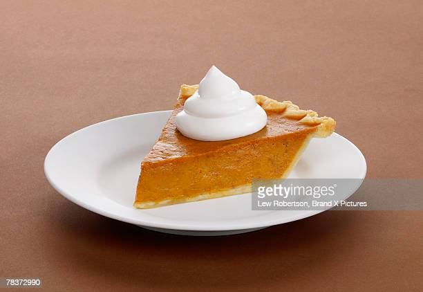 slice of pumpkin pie - whipped cream stock pictures, royalty-free photos & images