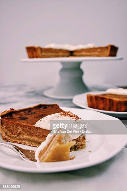 Slice Of Pumpkin Pie Served In Plate On Table