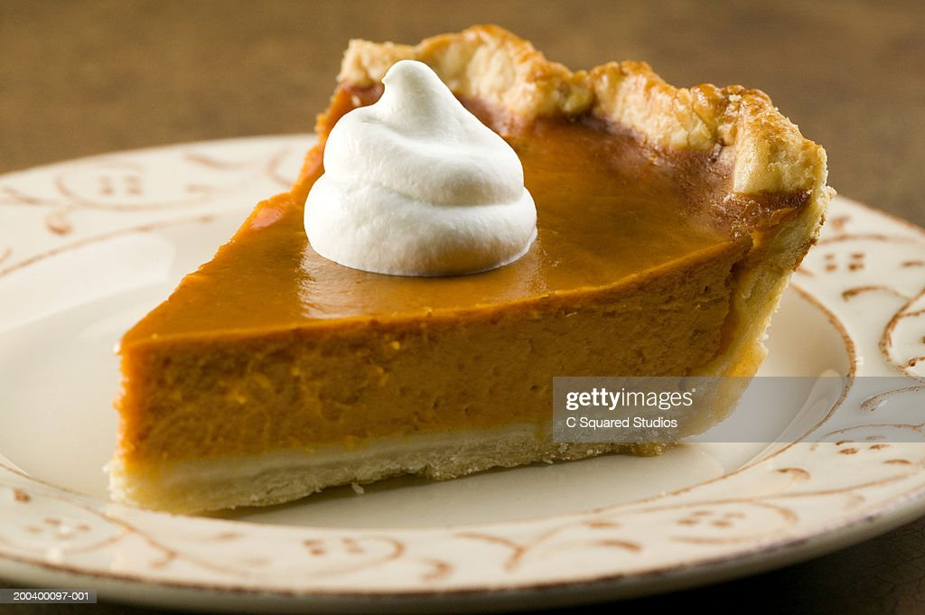 Slice of pumpkin pie with whipped cream on plate : Stock Photo