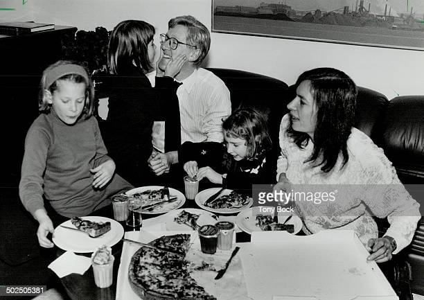 Slice of Rae's life Premier Bob Rae wife Arlene Perly Rae and children Lisa left Eleanor centre and Judith share a pizza in his Queen's Park office...