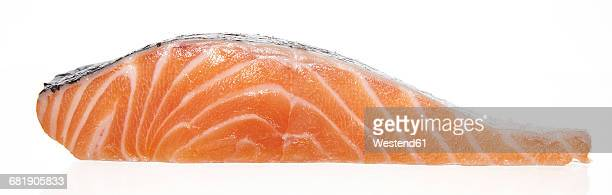 slice of raw salmon filet - fillet stock pictures, royalty-free photos & images