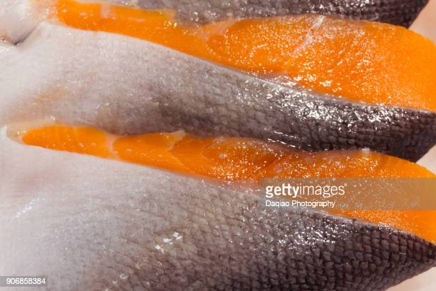 slice of raw salmon filet - redfish stock photos and pictures