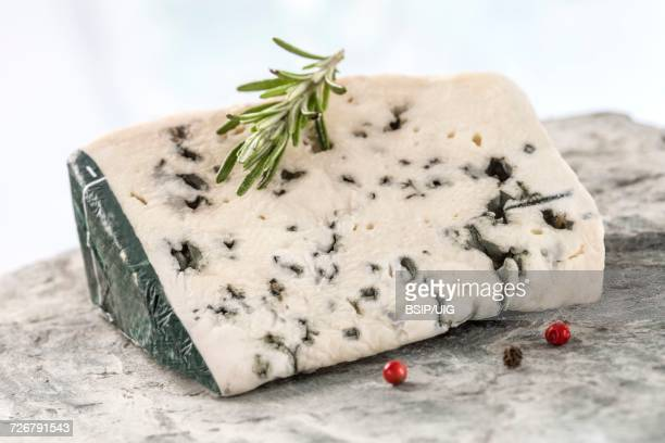 slice of roquefort, french cheese - roquefort cheese stock photos and pictures