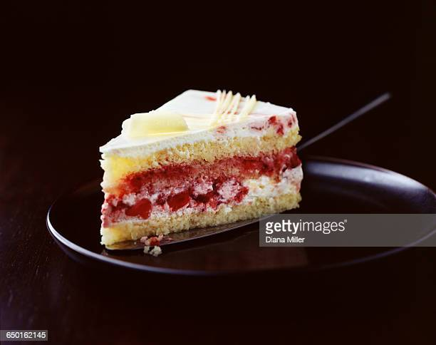 Slice of strawberry sponge cake on plate