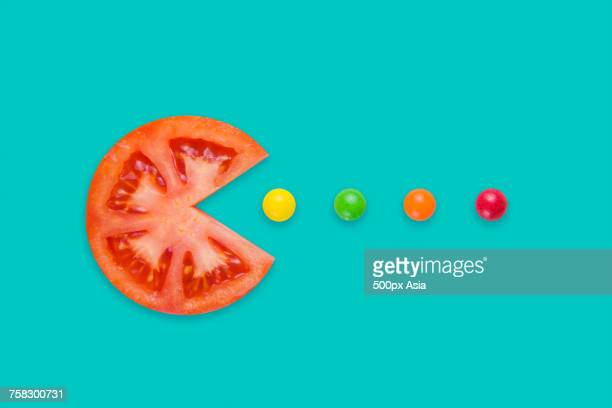 Slice of tomato and sweets representing Pacman meme, China
