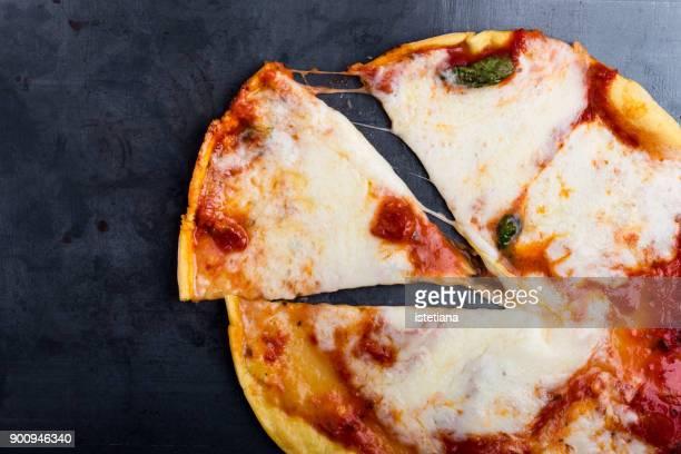 slice of traditional pizza margherita - pizza margherita foto e immagini stock