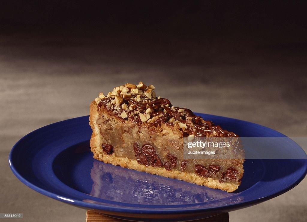 Slice of walnut crunch pie : Stock Photo