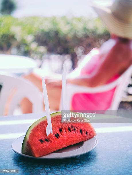 slice of watermelon ready to eat - plastic plate stock photos and pictures