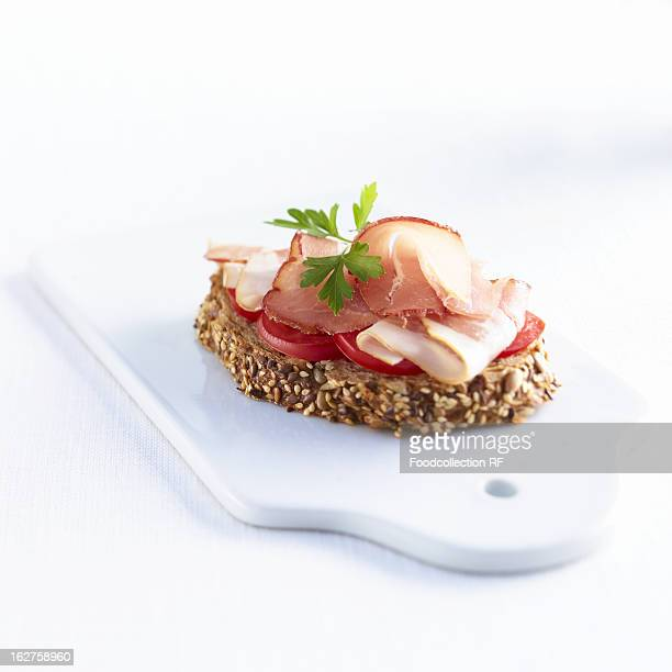 Slice of wholemeal bread with tomatoes and ham