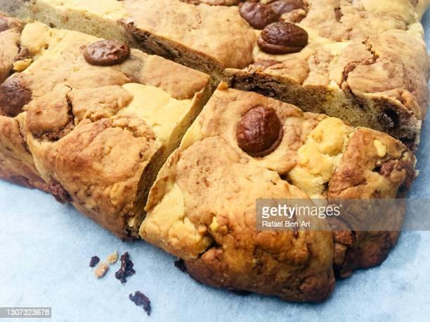 slice pf chocolate and  peanut butter brownie cake - rafael ben ari - fotografias e filmes do acervo