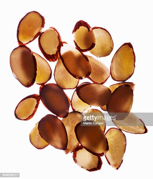 Sliced almonds on white background