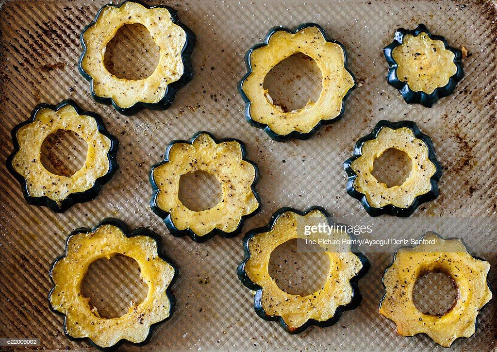 Sliced and roasted acorn squash : Stock Photo