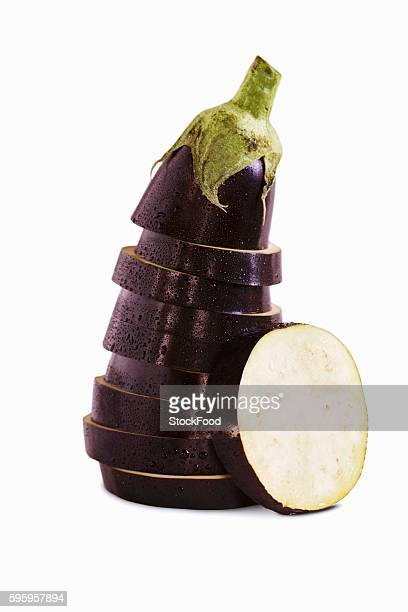 Sliced and Stacked Eggplant on White Background
