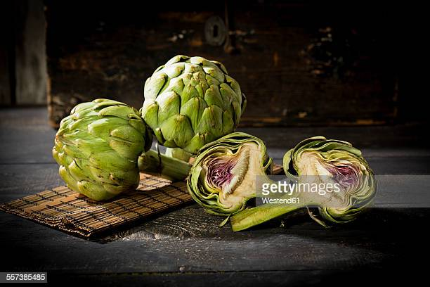 Sliced and two whole artichokes