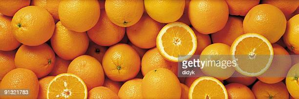 Sliced and whole oranges in a group