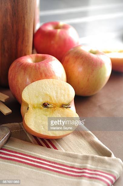 Sliced and whole red apples