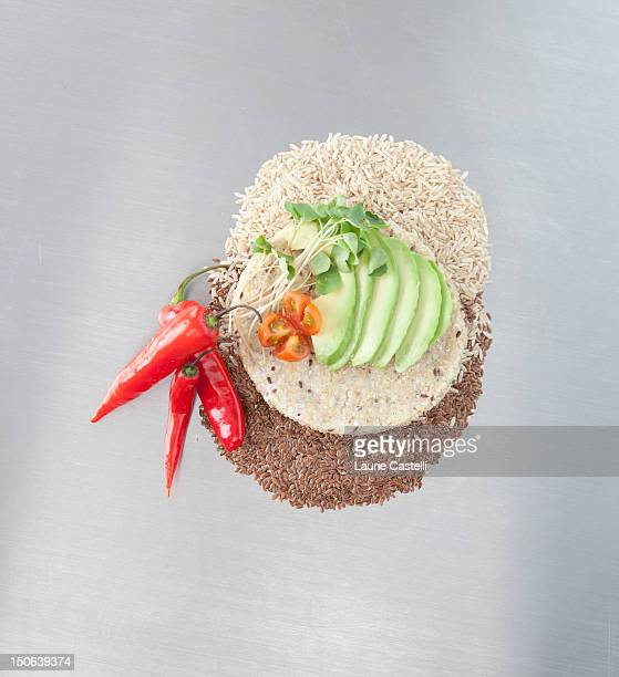 Sliced avocado and peppers with grains
