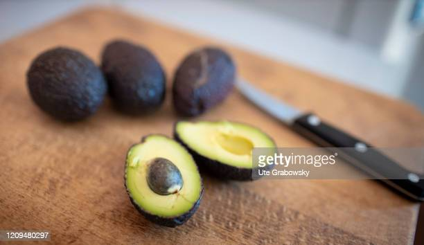 Sliced avocado with one core on April 08, 2020 in Bonn, Germany.
