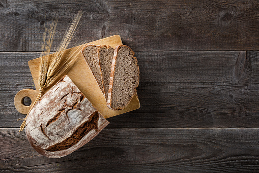 Sliced baked bread on cutting board 849764944