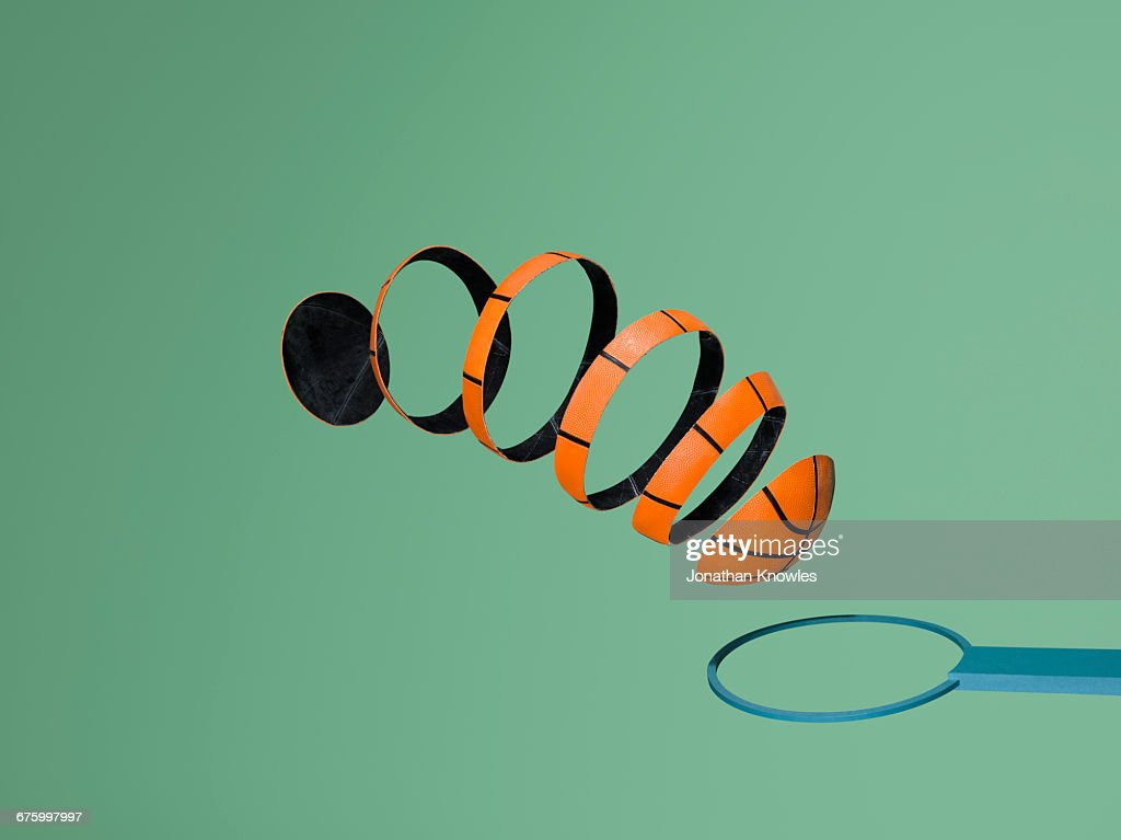 Sliced basketball makes its journey to score hoop : Stock Photo