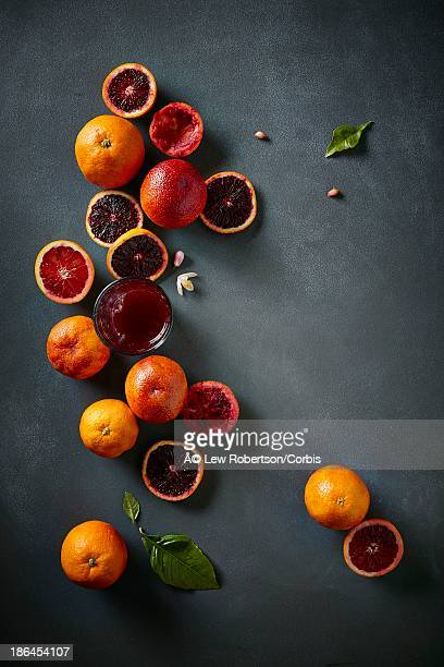 Sliced blood oranges and juice at a high angle