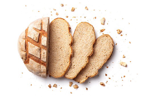 Sliced bread isolated on a white background. Bread slices and crumbs viewed from above. Top view 957824528