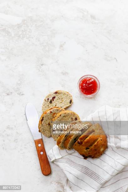 Sliced breads and strawberry jam