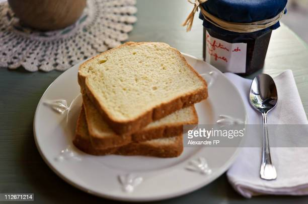 sliced brioche and homemade fig jam - brioche stock pictures, royalty-free photos & images