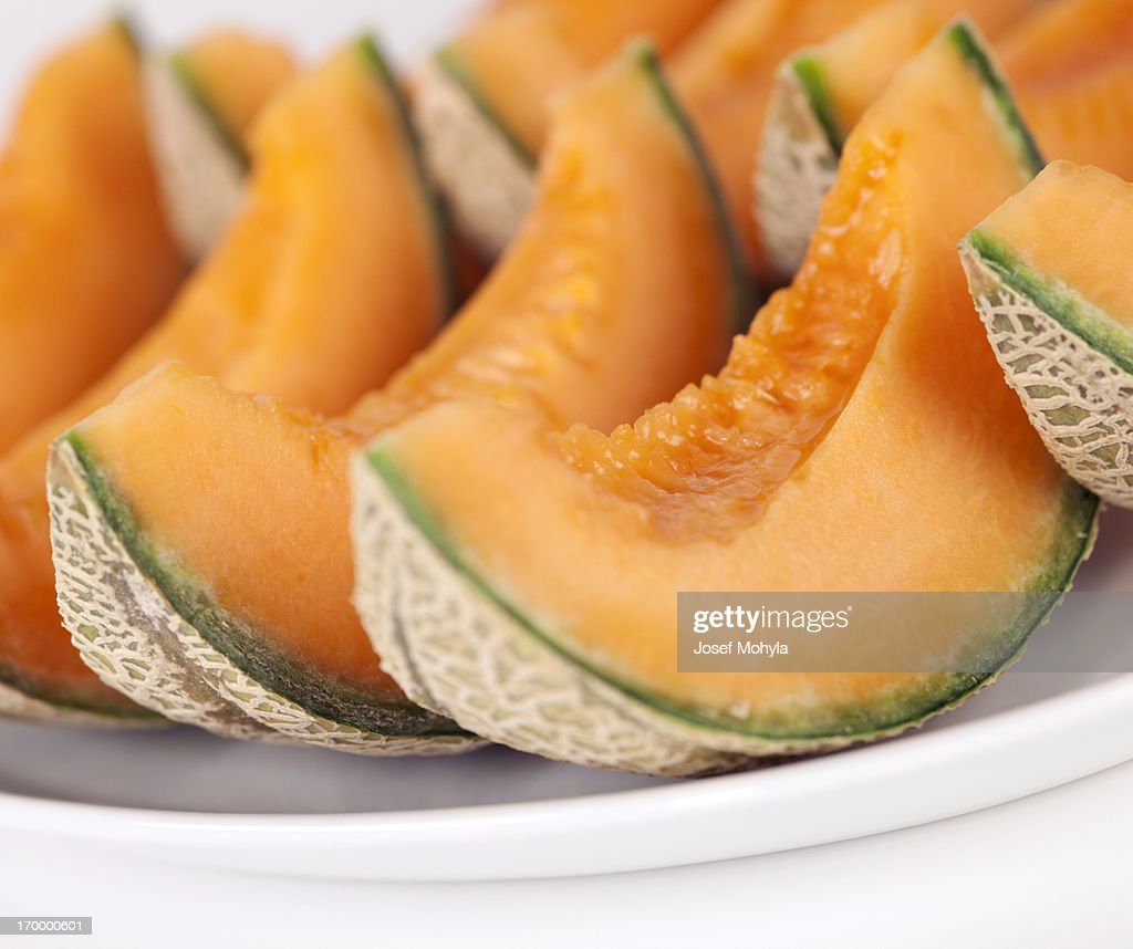 Sliced cantaloupe melons on a plate : Stock Photo