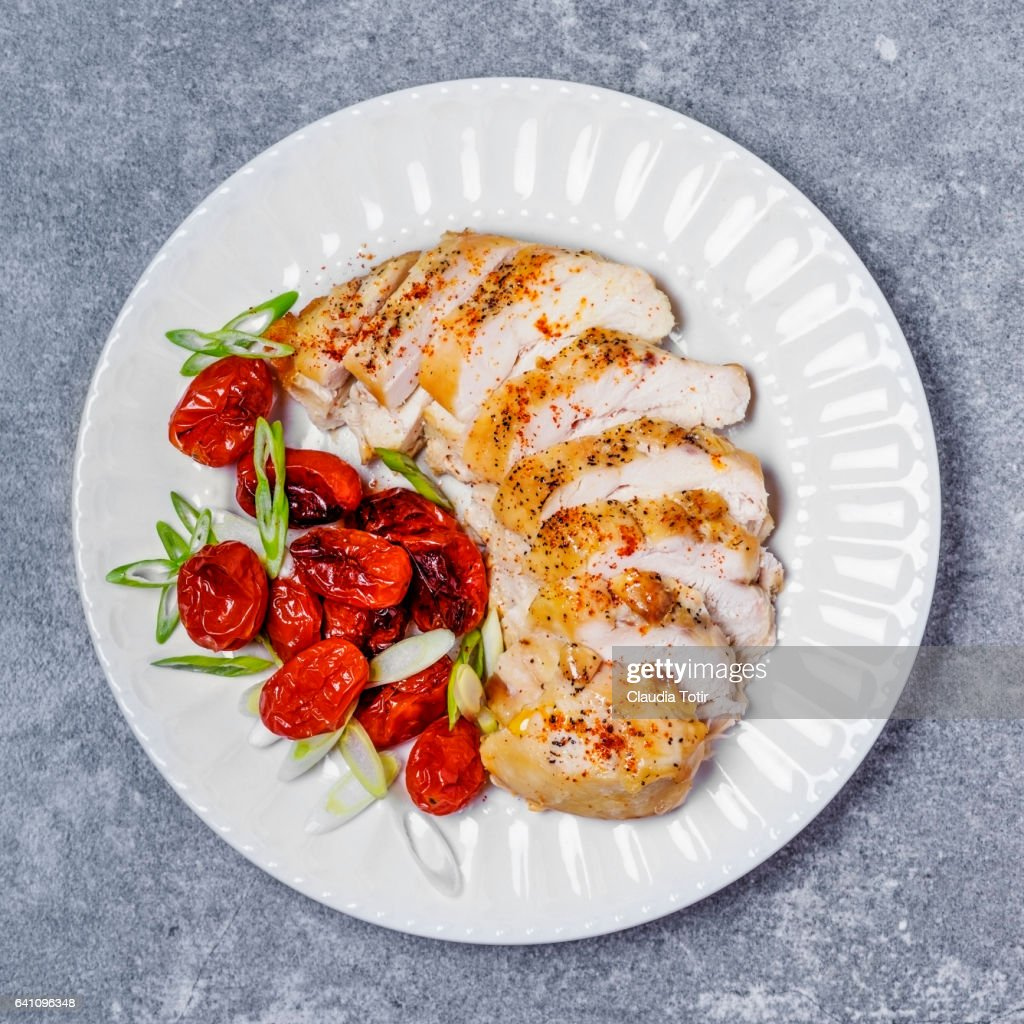 Sliced chicken on a plate : Stock Photo