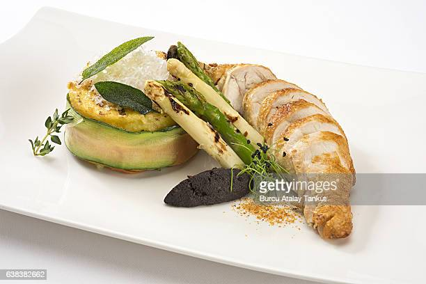 sliced chicken with avocado and asparagus