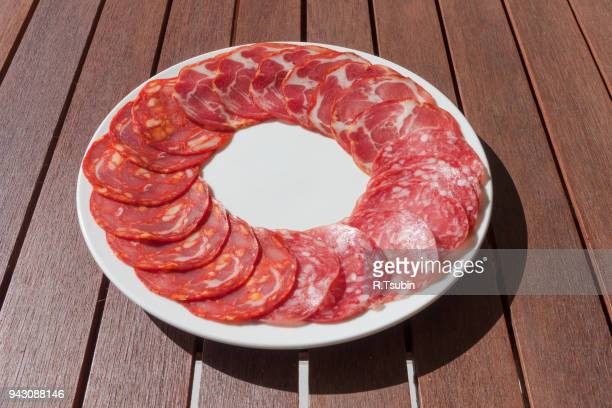 sliced chorizo sausage - cross processed stock pictures, royalty-free photos & images